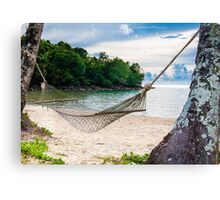 Hammock and palm trees on exotic tropical beach Canvas Print