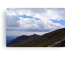 Beautiful natural scenery with mountains and cloudy sky. Canvas Print