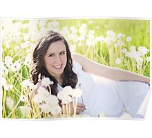 Beautiful young woman sitting in the grass Poster