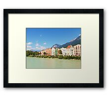 Buildings by the river Framed Print