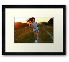 woman having fun with sunset Framed Print