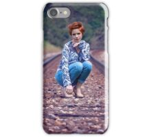woman sitting in the path of the train iPhone Case/Skin