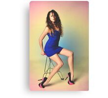 Girl sitting on a chair with a colored background Canvas Print