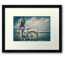 Girl with  her bike on the lake Framed Print