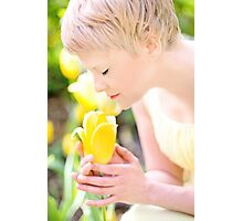 Young woman is yellow tulips flowers in the city Photographic Print