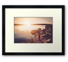 woman standing on the edge of the lake at sunset Framed Print