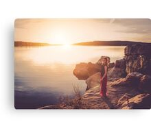 woman standing on the edge of the lake at sunset Canvas Print