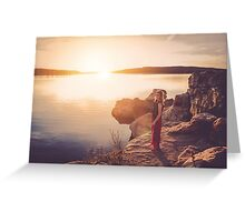 woman standing on the edge of the lake at sunset Greeting Card