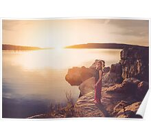 woman standing on the edge of the lake at sunset Poster