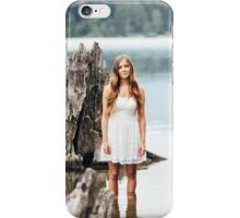 woman standing on the edge of the lake iPhone Case/Skin