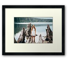 woman standing on the edge of the lake Framed Print
