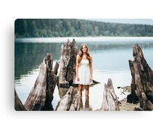 woman standing on the edge of the lake Canvas Print