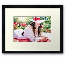Beautiful woman wearing a hat in summer Framed Print