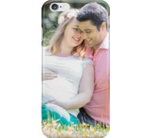 Pregnant woman with her husband in the garden iPhone Case/Skin