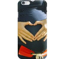 Pregnant woman making heart with her hands iPhone Case/Skin