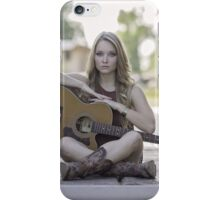 Pretty and young woman playing a guitar iPhone Case/Skin
