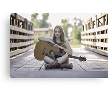 Pretty and young woman playing a guitar Canvas Print