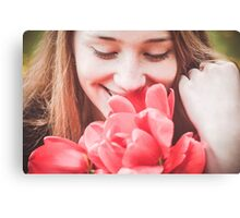Happy woman with red flowers Canvas Print