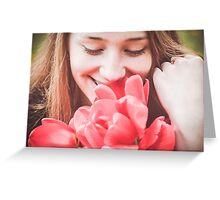 Happy woman with red flowers Greeting Card