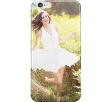 Woman playing in nature iPhone Case/Skin