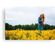 Blonde woman in a yellow flowers field Canvas Print