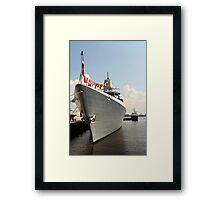 warship with flags at the pier Framed Print