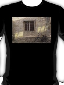 Bike leaning against Wall T-Shirt