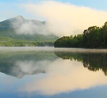 Cloud and Mountain Landscape reflections on White Lake by Roupen  Baker