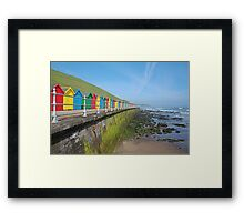 Multicoloured beach houses at Whitby Framed Print