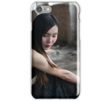 Frontal photo of young stress woman against wall iPhone Case/Skin