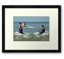 Dad and the boys playing in the water. Framed Print