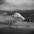Taranaki amongst the clouds, New Zealand by Norman Repacholi