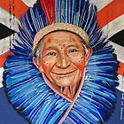 Amazonian Village Chief with blue feather head dress by Colombe  Cambourne