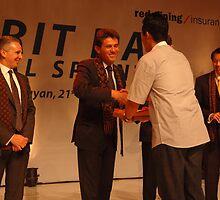 AXA CEO-Henri de Castries receiving gift from AXA indonesia by bayu harsa