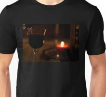 A Glass of Red wine in candle-light. Unisex T-Shirt