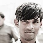 Portrait of a Young Man in Delhi by Valerie Rosen