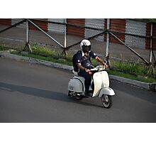 man riding scooter Photographic Print