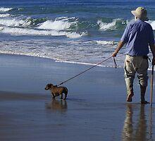 A man and his dog at Pippi Beach by myraj