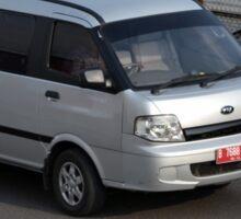 silver colored KIA travello Sticker