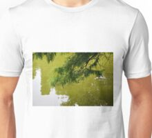 Tree branch leaning over a green lake. Unisex T-Shirt