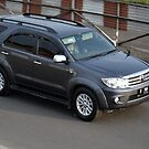 grey colored toyota fortuner by bayu harsa
