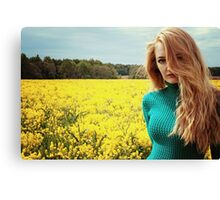 Beautiful young woman in flower field Canvas Print