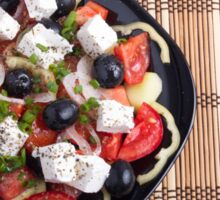 Top view of a Greek salad with fresh vegetables Sticker