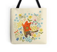 The cat catching a bird. Tote Bag