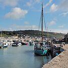 Wooden Sailboat At Lyme Regis Harbour by Susie Peek
