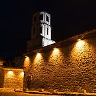 Of Stone Walls and Bell Towers - Yellow Lit Night in Old Town Plovdiv, Bulgaria by Georgia Mizuleva
