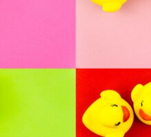 Pair of yellow rubber ducks isolated over colorful background, love concept Sticker