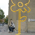 Banksy Yellow Lines Flower Painter by ManwithaCamera