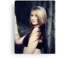 Portrait of blond young woman posing outdoors Canvas Print