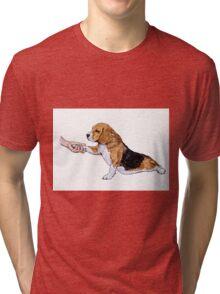 Human hand holding beagle's leg Tri-blend T-Shirt
